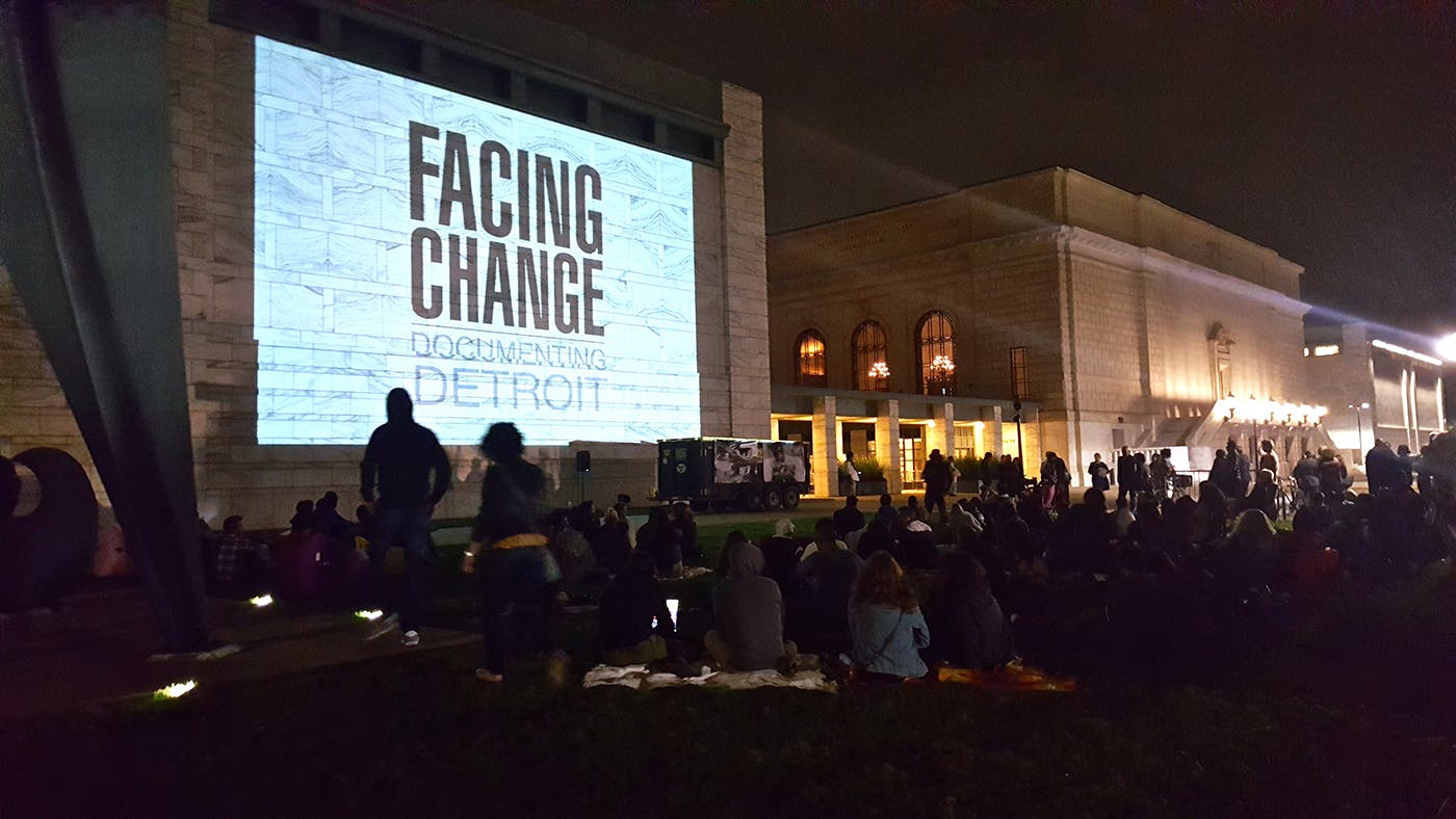 <p>The &quot;Facing Change: Documenting Detroit&quot; slideshow drew a crowd as diverse as the images it presented.</p>