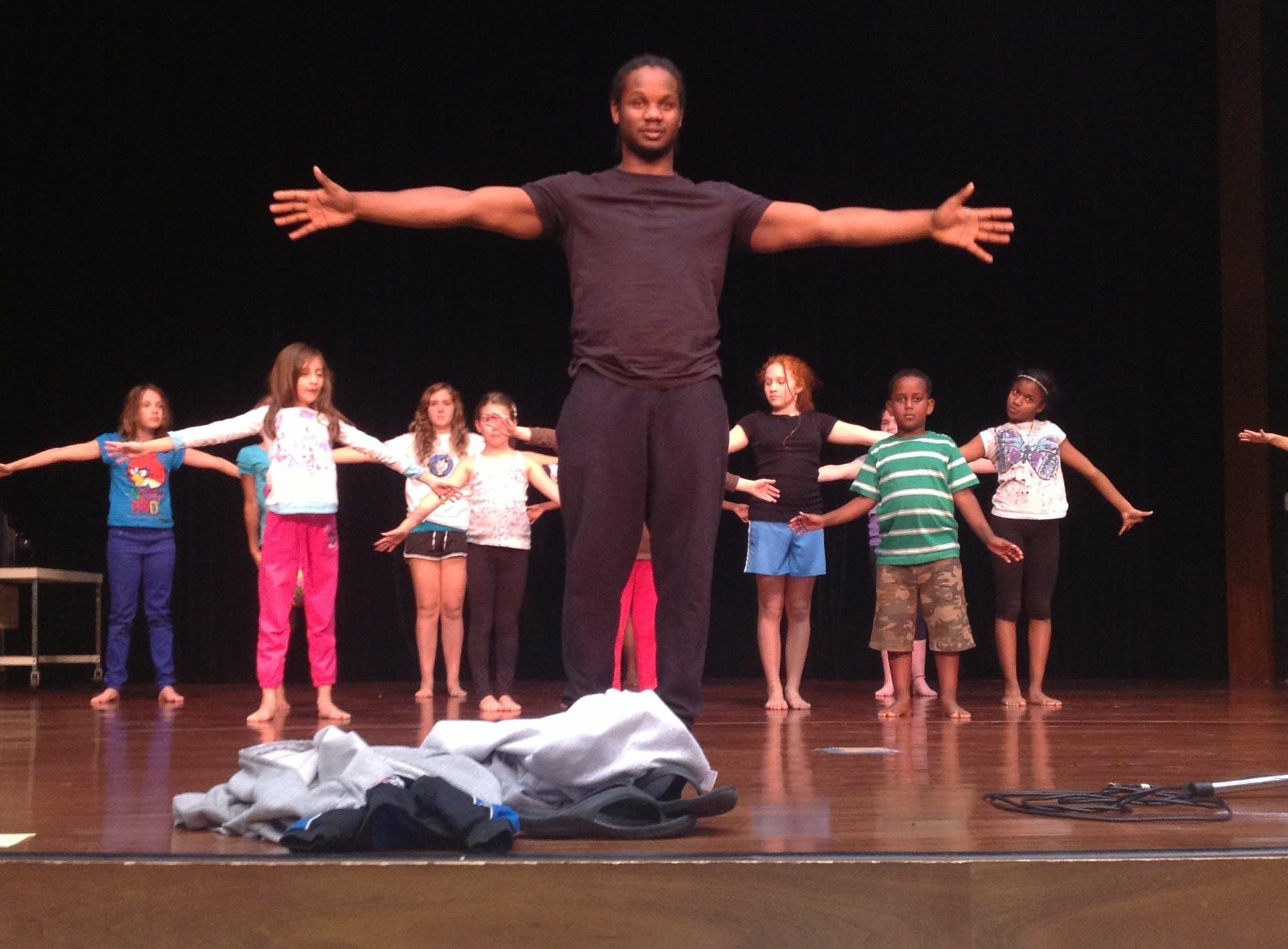<p><em><em>Dominic Moore-Dunson teaching at Ratner School</em>. Photo courtesy of Inlet Dance Theatre.</em></p>
