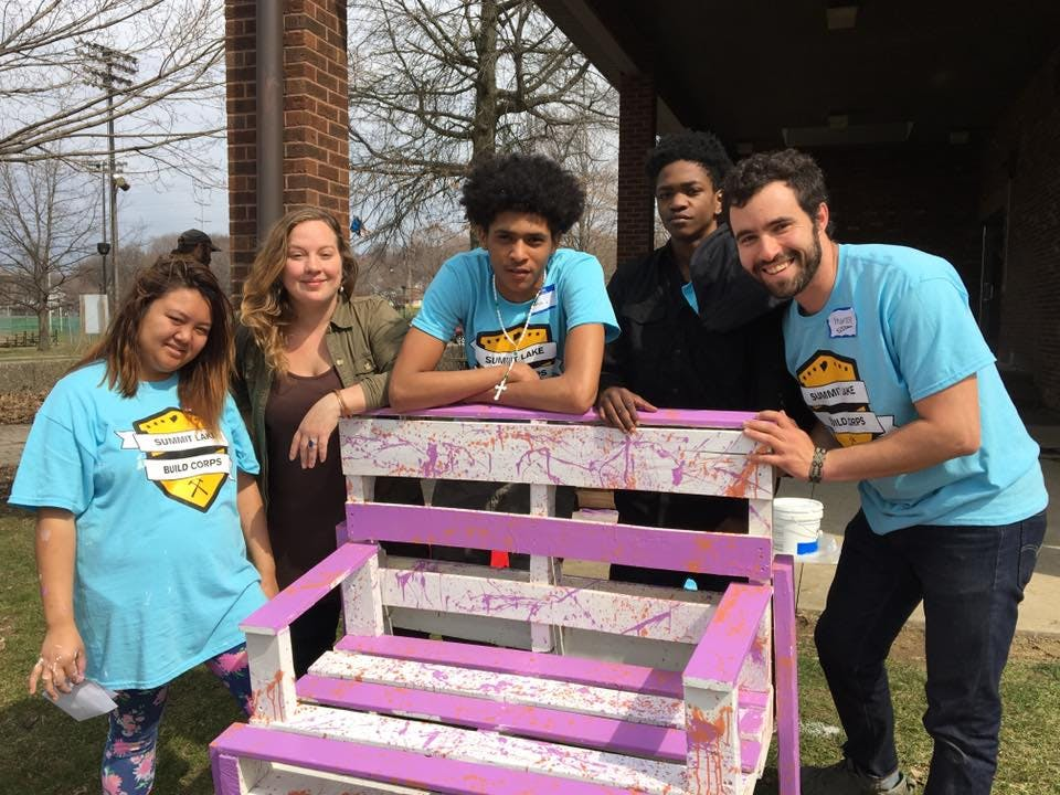 <p><em>Members of the Summit Lake Build Corps pose with their finished bench. From left to right, Julie, League of Creative Interventionists fellow Megan Shane, Ramon, Markado, and League founder Hunter Franks.</em></p>