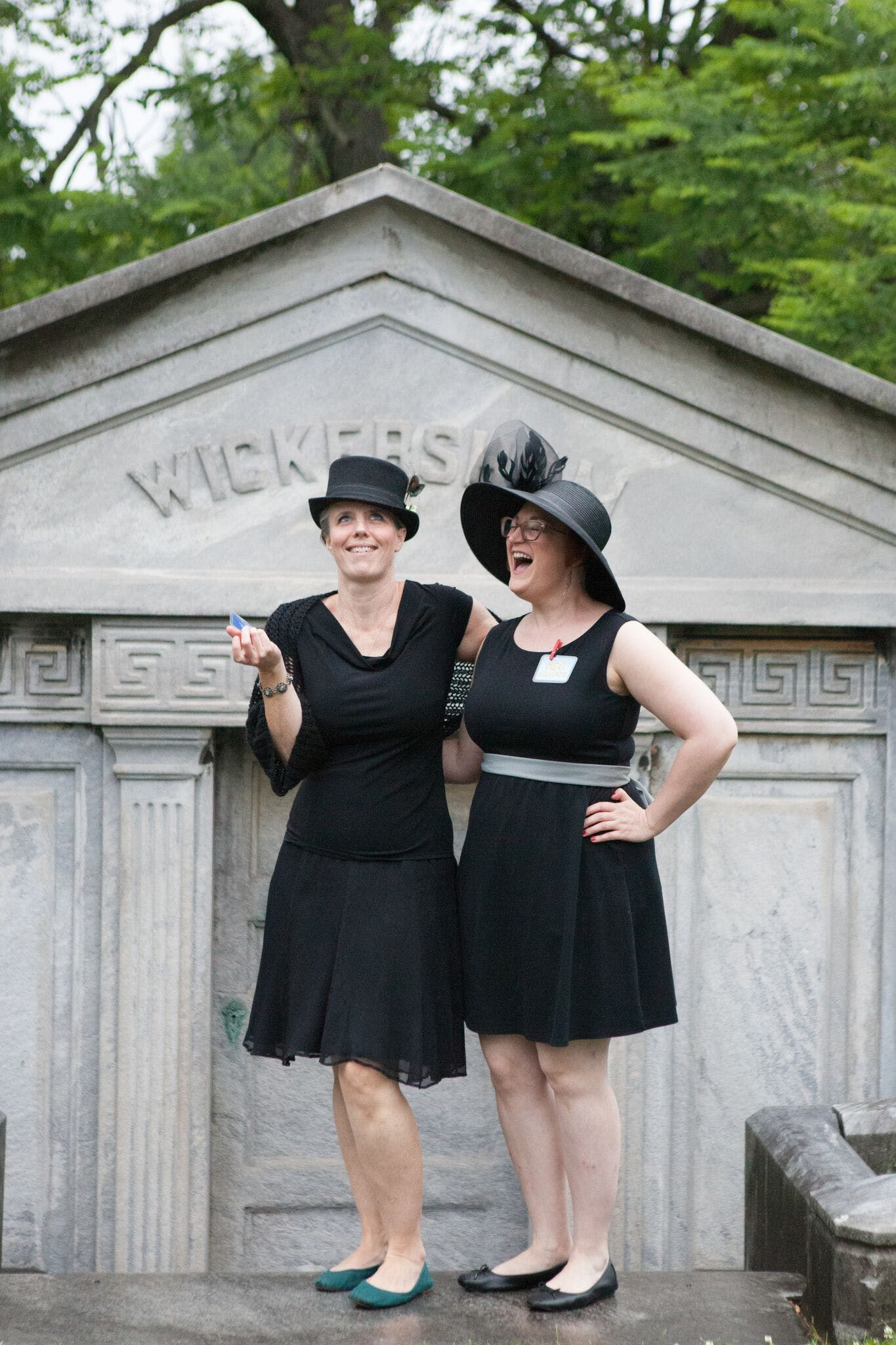 <p><em>Journeyers Kristy Smith and Meghann Williams sharing their experience during the Woodlands Cemetery walk at the closing party for &ldquo;The End.&rdquo;&nbsp;</em>Photo: Kate Raines</p>