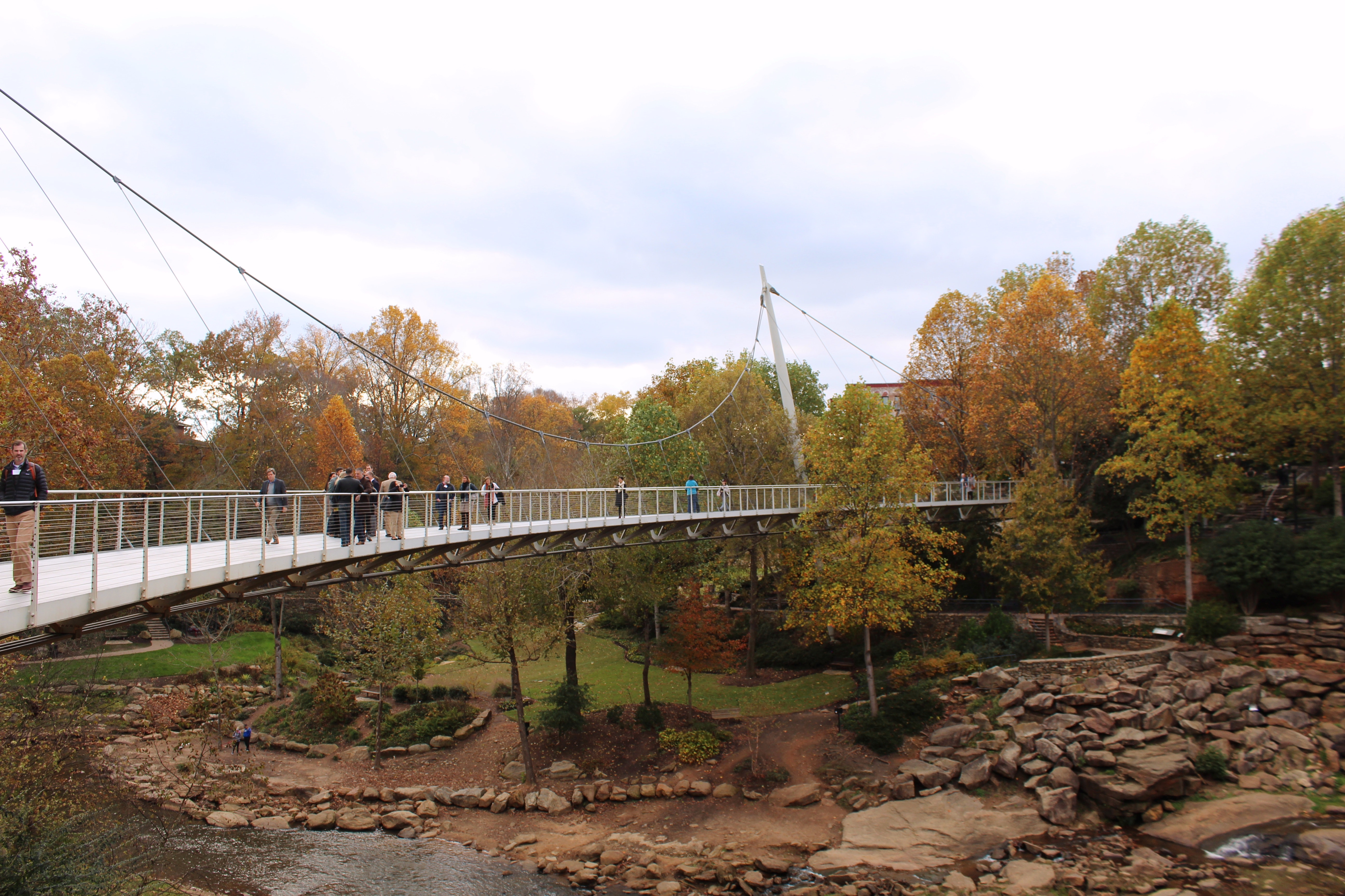 <p><em>Parkland in Greenville was reclaimed by removing a highway bridge, revealing the waterfall underneath, and developing people-friendly park features, including a new pedestrian bridge that anchors the transformed space.</em></p>