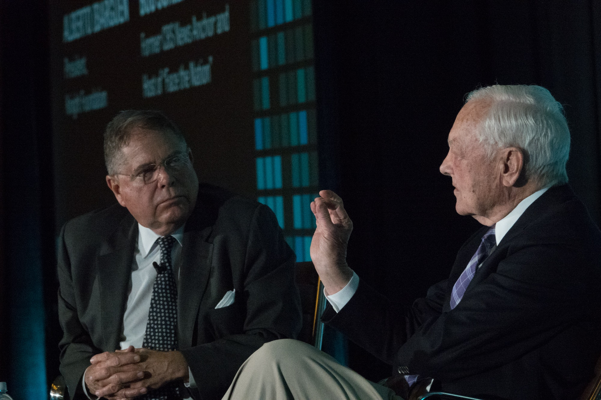 <p>Knight Foundation President Alberto Ibargüen listens attentively as veteran newsman Bob Schieffer discusses other times in history when technological advancement was followed by a period of disruption. Photo: Angel Valentin</p>