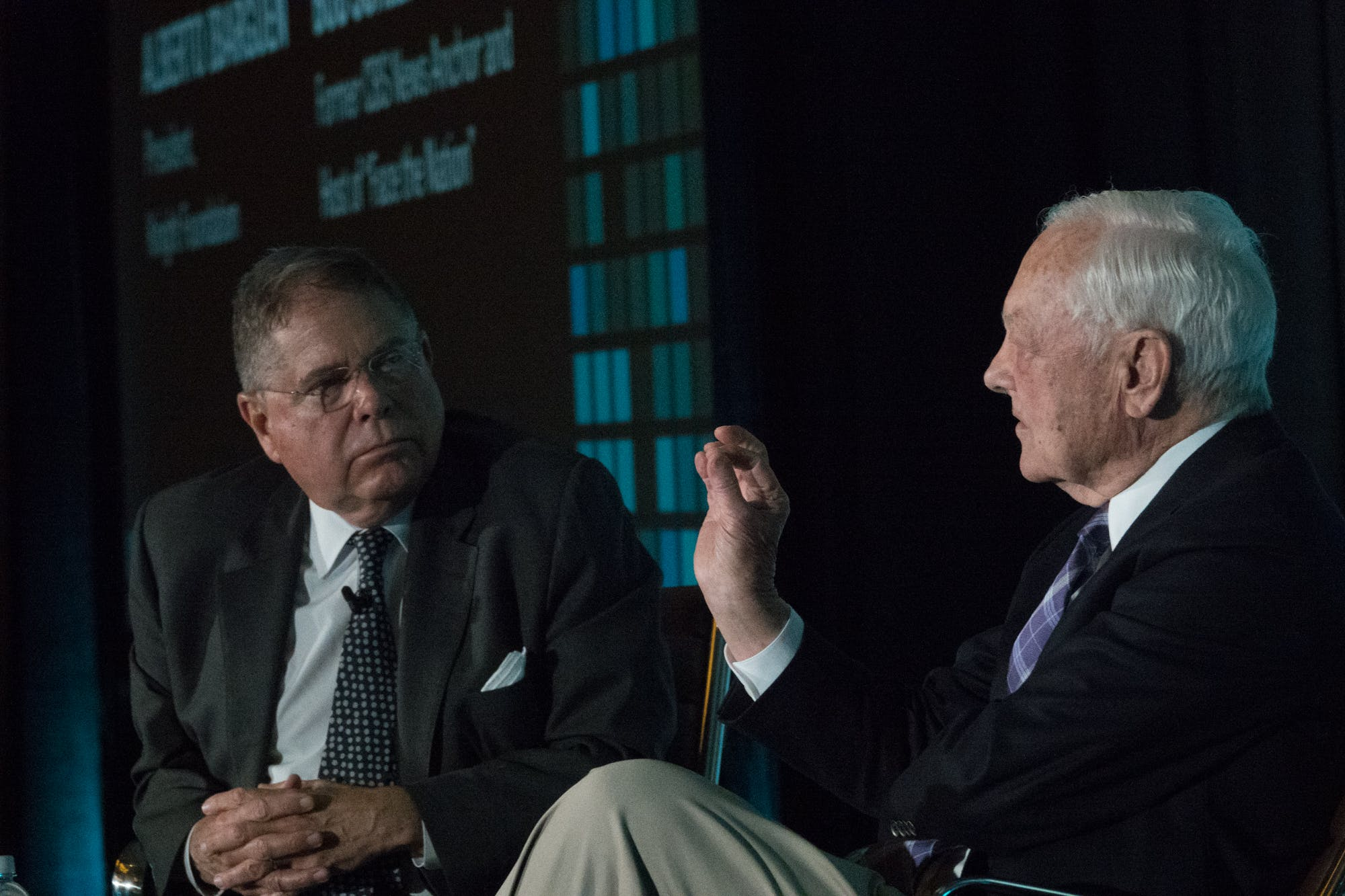 <p>Knight Foundation President Alberto Ibarg&uuml;en listens attentively as veteran newsman Bob Schieffer discusses other times in history when technological advancement was followed by a period of disruption. Photo: Angel Valentin</p>