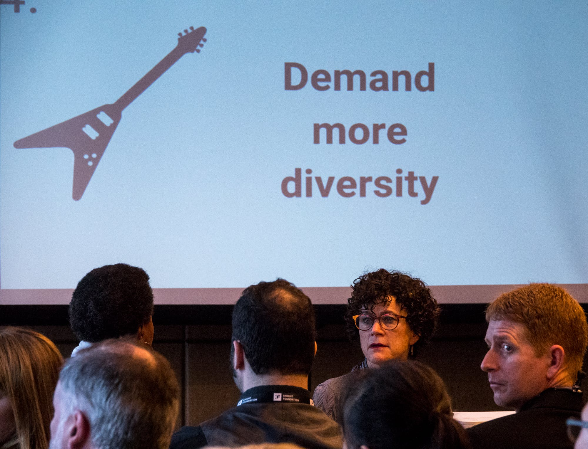 <p>Audience members at the Community Focused Journalism panel get the message at the 2018 Knight Media Forum. Photo by Angel Valentin</p>